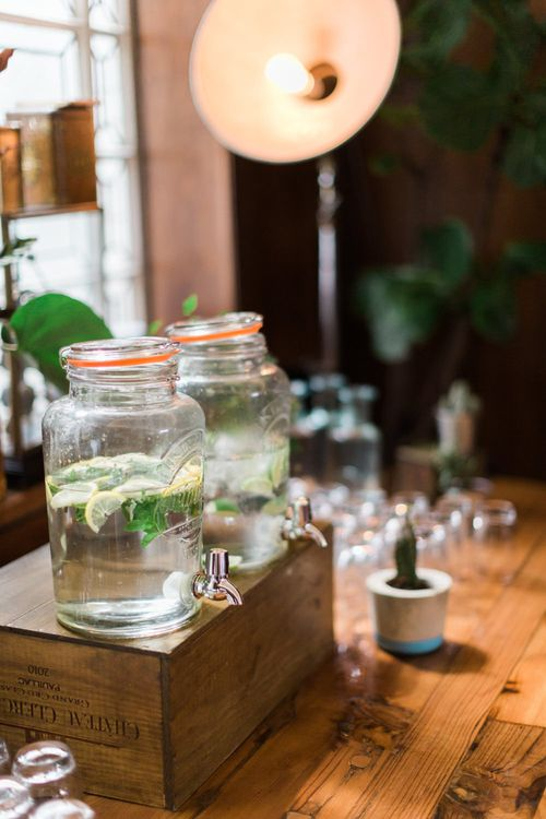 Large Kilner Jars | Upturned Wooden Wine Box | Industrial Photographic Floor Lamp | Neon Sign and Marine Green Rewritten Bridesmaids Dresses with Lace Cape Grace Loves Lace Gown | Alain Mbouche Photography