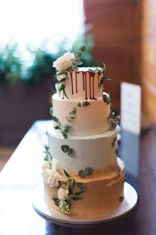 Four-Tier Wedding Cake by Lily Vanilli with Green and Gold Ombre Icing and Drippy Detail | Neon Sign and Marine Green Rewritten Bridesmaids Dresses with Lace Cape Grace Loves Lace Gown | Alain Mbouche Photography