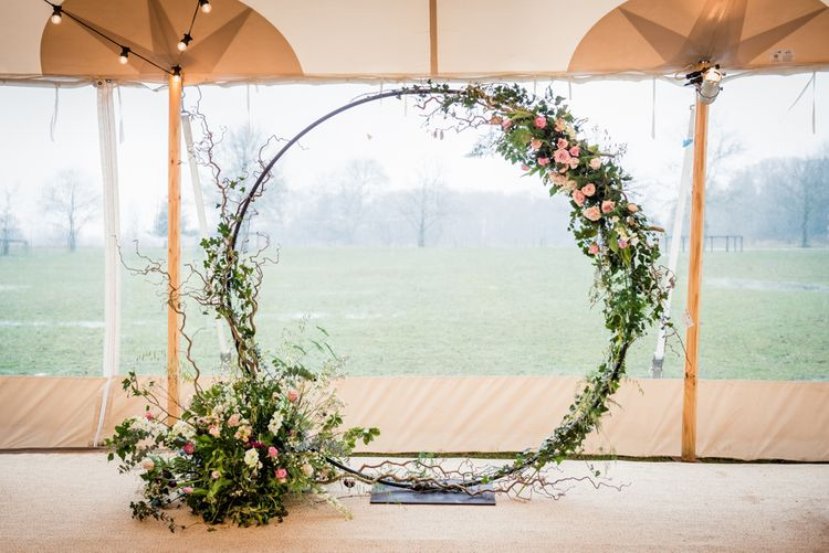 Floral Circle Photo Booth Backdrop // Sperry Tent Wedding With Romantic Meadow Inspired Styling