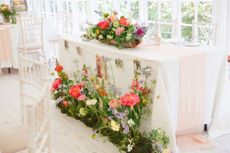 Top Table Wedding Floral Arrangement with Pink Peonies | Spring Wedding Colours for 2019 | Bold & Bright Spring Wedding Inspiration by Helaina Storey Wedding Design | Flowers by Bloomologie | Palette Signs by Made by Wood & Wood | Claire Graham Photography
