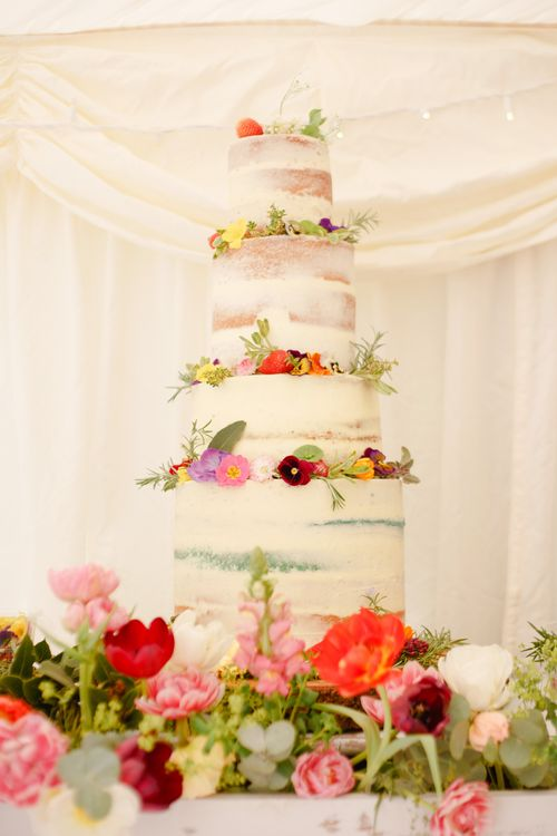 Semi Naked Wedding Cake with Spring Wedding Flowers | Spring Wedding Colours for 2019 | Bold & Bright Spring Wedding Inspiration by Helaina Storey Wedding Design | Flowers by Bloomologie | Palette Signs by Made by Wood & Wood | Claire Graham Photography