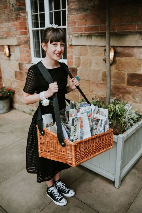 Flower Girl Holding a Basket Full of Wedding Newspapers