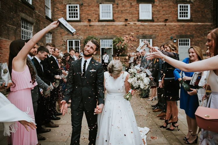 Bride and Groom Confetti Moment at The West Mill Wedding Venue