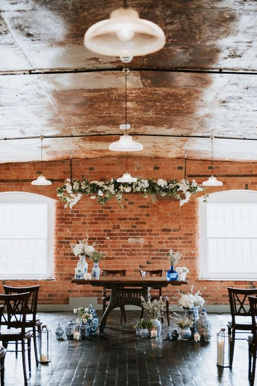 Wedding Ceremony Altar with Blue and White Vases and White Flowers