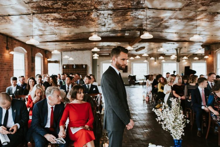 Groom Standing at the Altar of a The West Mill Wedding Ceremony