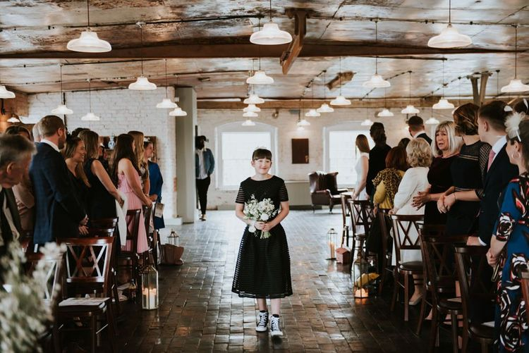 Flower Girl Walking Down the Aisle in a Black Dress and Trainers