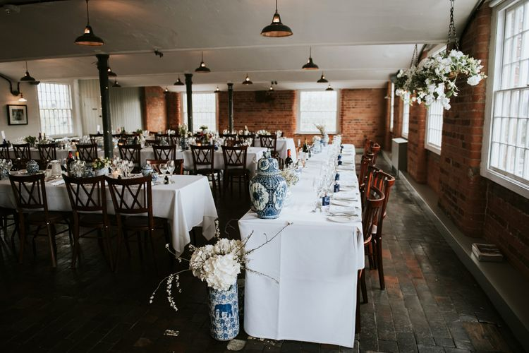 Blue and White Wedding Reception Details at Industrial Wedding Venue