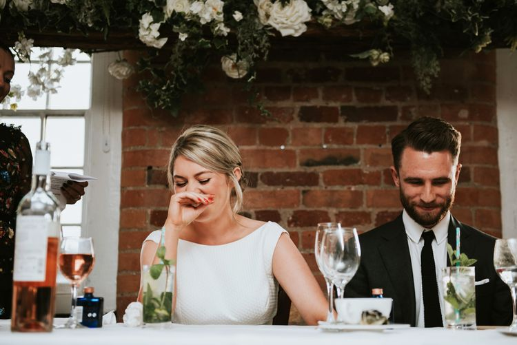 Bride and Groom Laughing at the Top Table