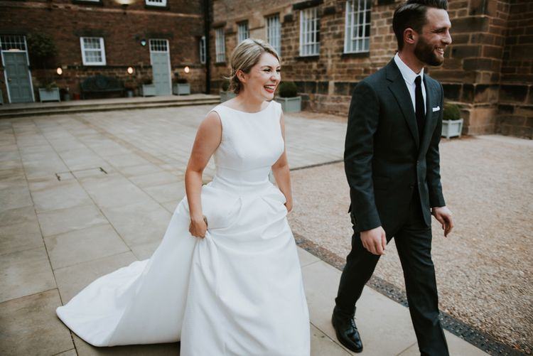 Beautiful Bride in High Neck Plain Wedding Dress and Groom in Black Suit with Skinny Tie