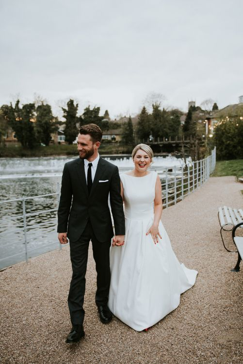 Stylish Bride and Groom Walking By the Stream at The West Mill
