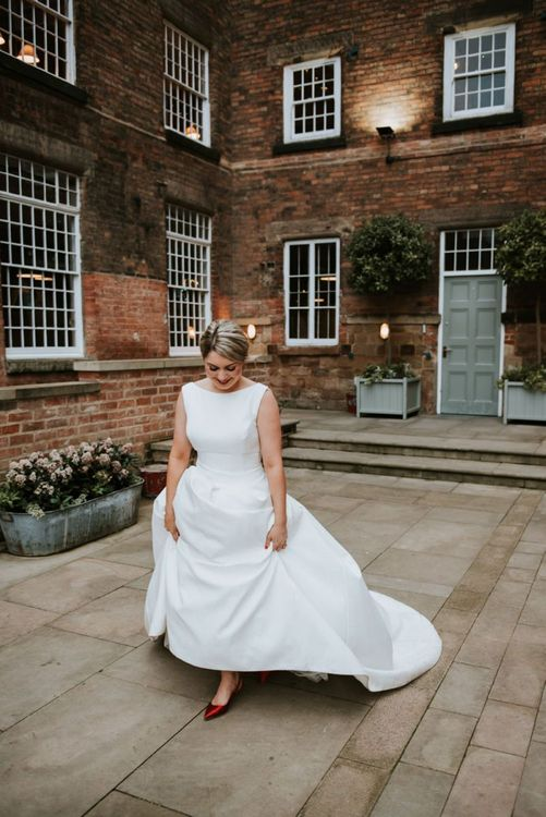 Beautiful Bride in Fitted Bodice Wedding Dress with Full Skirt and Red Satin Shoes