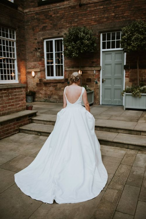 Bride in Low Back Wedding Dress with Full Skirt