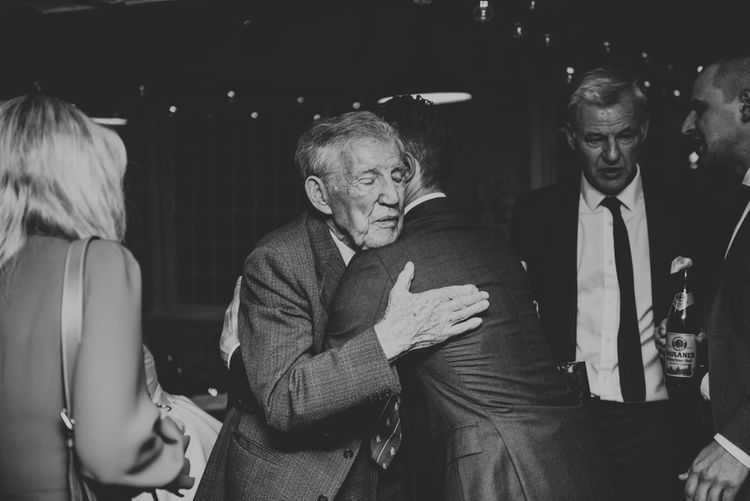Groom Hugging His Grand Father
