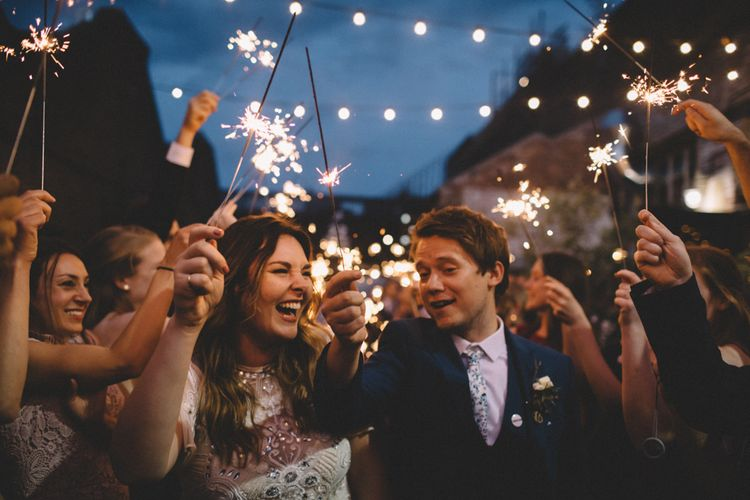 Sparklers At Wedding // The Clapton Country Club London Wedding With Bride In Embellished Dress With Images From Carrie Lavers Photography