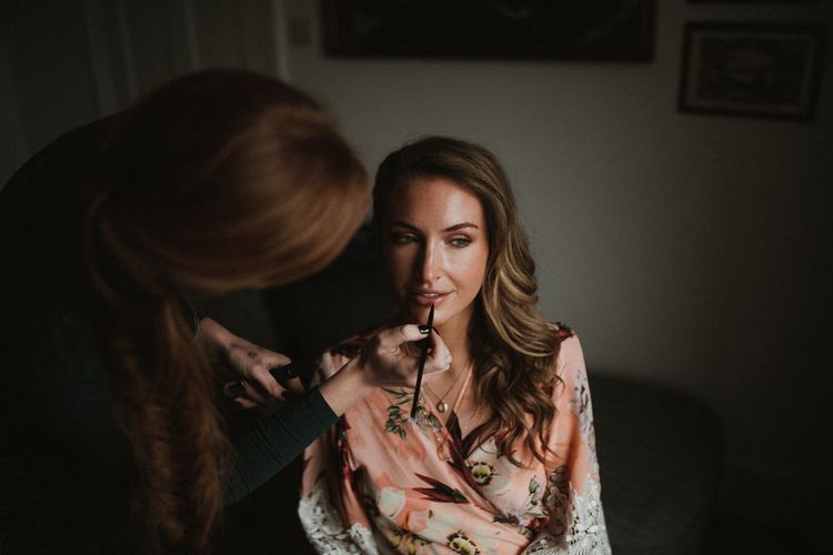 Bride Getting Ready For Wedding Wearing Floral Mae's Sunday Robe // Image By James Frost