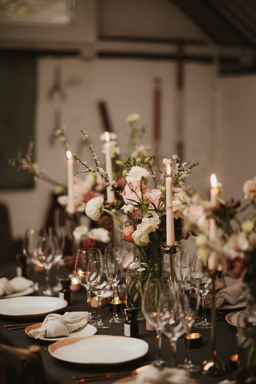 Boat House Wedding Reception With Pink Toned Florals And Ivory Tapered Candles // Images By James Frost Photography