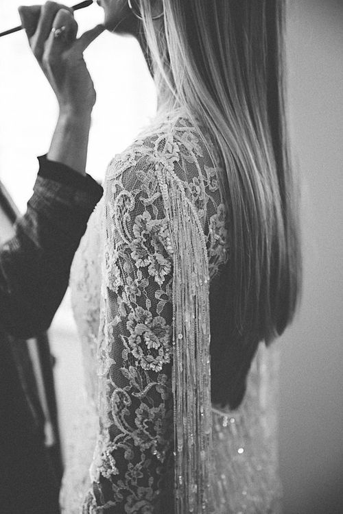 Back of lace and beaded boho bridal dress with tassel detailing
