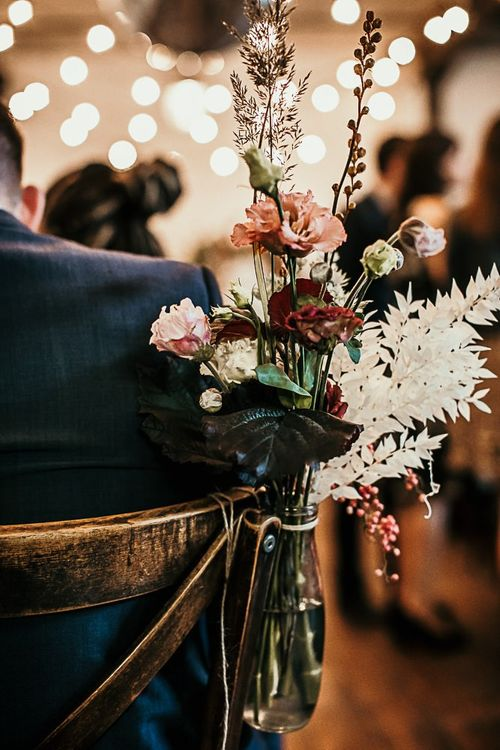 Pink flower and foliage chair decor at Clapton Country Club wedding