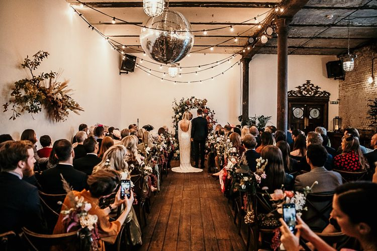 Clapton Country Club wedding ceremony with festoon lighting and a disco ball