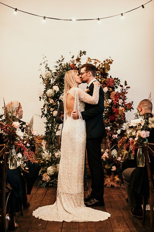 Bride and groom tie the knot at Clapton Country Club wedding ceremony with botanical styling