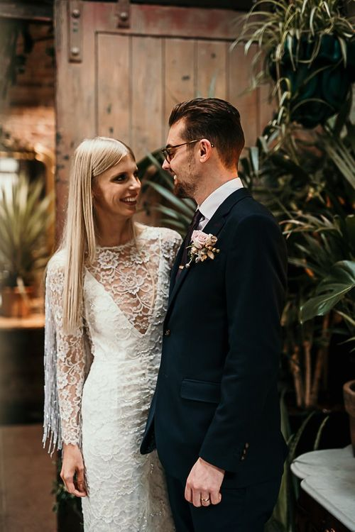 Bride wearing a lace and beaded boho style dress