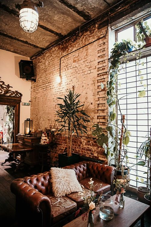 Reception decor with foliage details and botanical styling for city celebration