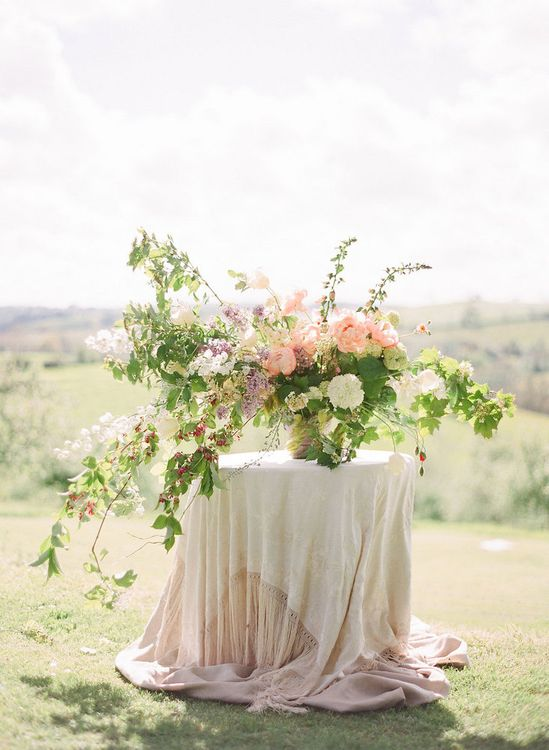 Large Pink Summer Wedding Flowers Centrepiece by The Garden Gate Flower Company - Image by Taylor and Porter Photographs
