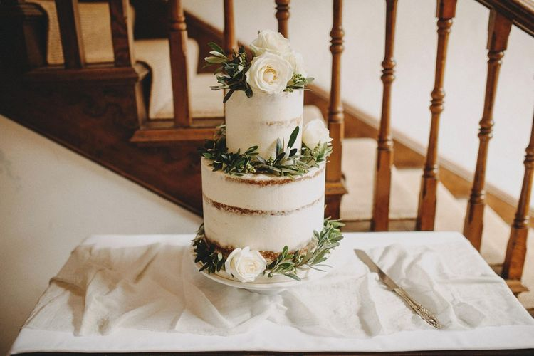 White Semi Naked Buttercream Wedding Cake / Image By Ali Paul Photography