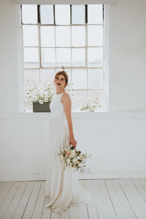 Bride in minimalist wedding dress with dark lipstick