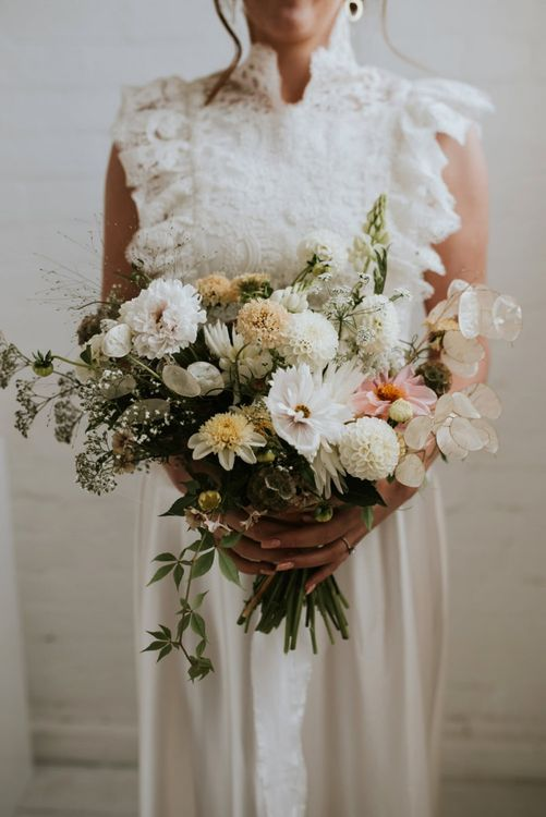 minimalist wedding bouquet with white dahlias