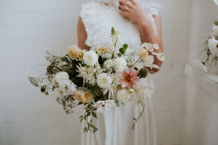 delicate wedding bouquet with white dahlias, stocks and foliage