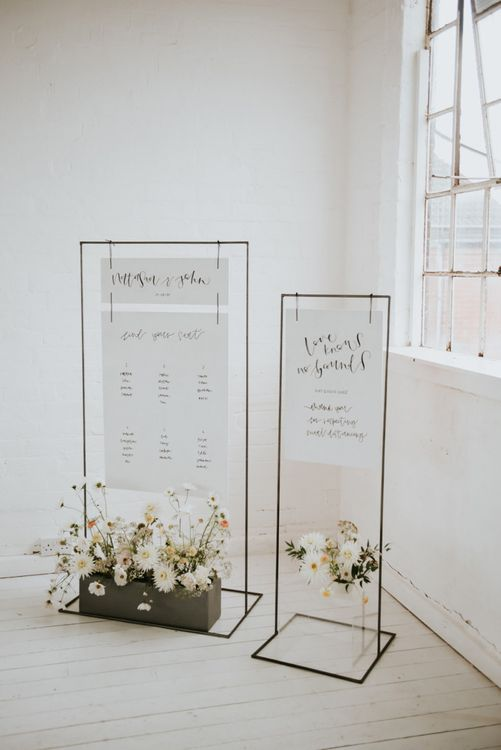 minimalism wedding sign and table plan on site frame