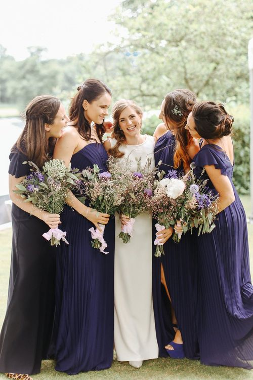 Bridal Party | Bridesmaids in Pleated Navy Dresses | Bride in Alan Hannah Gown from Teokath London | Copper, Marble & Foliage Glass Marquee Wedding & Outdoor Ceremony on Temple Island in Oxfordshire | Belle and Beau Fine Art Photography
