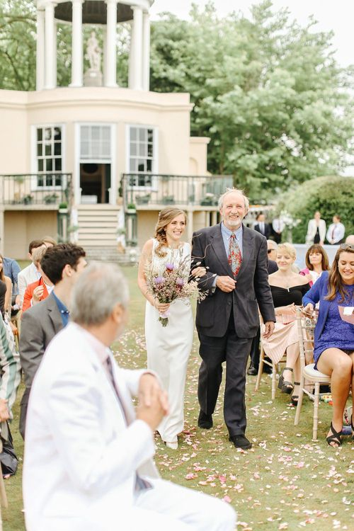 Wedding Ceremony | Bridal Entrance in Alan Hannah Gown from Teokath London | Copper, Marble & Foliage Glass Marquee Wedding & Outdoor Ceremony on Temple Island in Oxfordshire | Belle and Beau Fine Art Photography