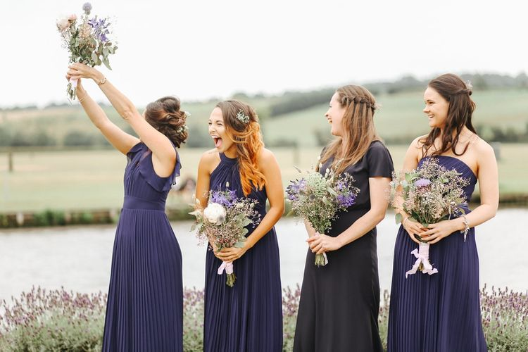 Bridesmaids in Pleated Navy Dresses | Copper, Marble & Foliage Glass Marquee Wedding & Outdoor Ceremony on Temple Island in Oxfordshire | Belle and Beau Fine Art Photography