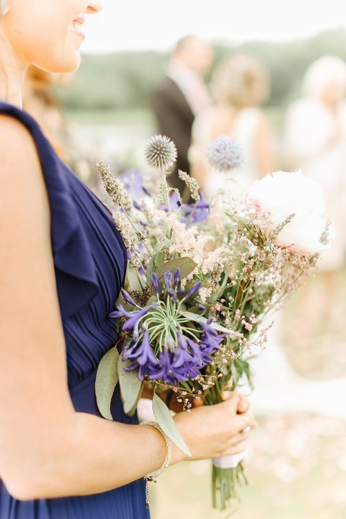 Hand Picked Wedding Posey | Bridesmaid in Pleated Navy Dress | Copper, Marble & Foliage Glass Marquee Wedding & Outdoor Ceremony on Temple Island in Oxfordshire | Belle and Beau Fine Art Photography