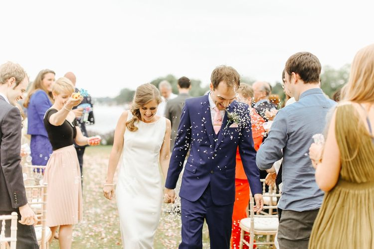 Wedding Ceremony | Confetti Exit | Bride in Alan Hannah Gown | Groom in Navy Blue TM Lewin Suit | Copper, Marble & Foliage Glass Marquee Wedding & Outdoor Ceremony on Temple Island in Oxfordshire | Belle and Beau Fine Art Photography