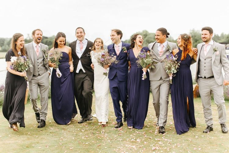 Wedding Party | Bride in Alan Hannah Gown | Bridesmaids in Navy Dresses |  Groom in Navy Blue TM Lewin Suit Groomsmen in Light Grey French Connection Suits | Copper, Marble & Foliage Glass Marquee Wedding & Outdoor Ceremony on Temple Island in Oxfordshire | Belle and Beau Fine Art Photography