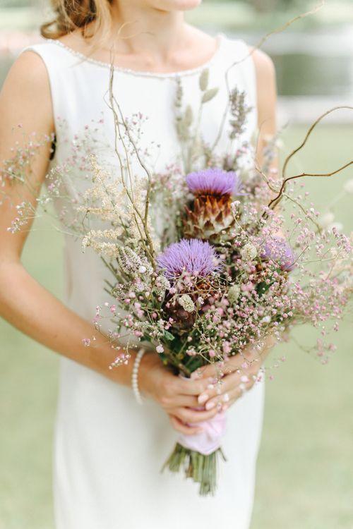 Wild Flower Purple Wedding Bouquet | Bride in Alan Hannah Gown | Copper, Marble & Foliage Glass Marquee Wedding & Outdoor Ceremony on Temple Island in Oxfordshire | Belle and Beau Fine Art Photography