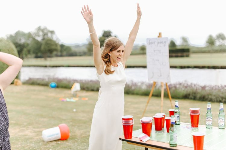 Bear Pong Garden Games | Bride in Alan Hannah Gown | Copper, Marble & Foliage Glass Marquee Wedding & Outdoor Ceremony on Temple Island in Oxfordshire | Belle and Beau Fine Art Photography