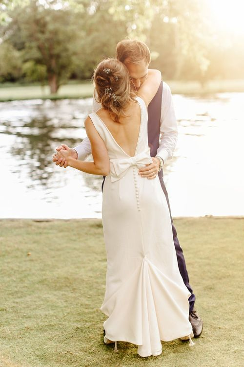 Bride in Alan Hannah Gown | Groom in Navy Blue TM Lewin Suit | Copper, Marble & Foliage Glass Marquee Wedding & Outdoor Ceremony on Temple Island in Oxfordshire | Belle and Beau Fine Art Photography