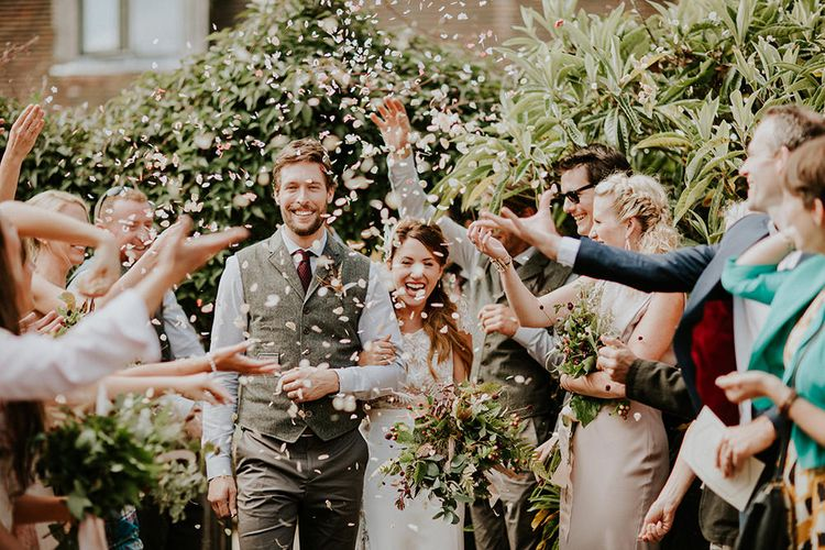 Confetti Exit | Bride in Amanda Thompson Couture Gown | Groom in Reiss Suit | Feather & Foliage Festival Wedding Weekend at Copse House, Berkshire | Irene Yap Photography | Tanita Cox Films