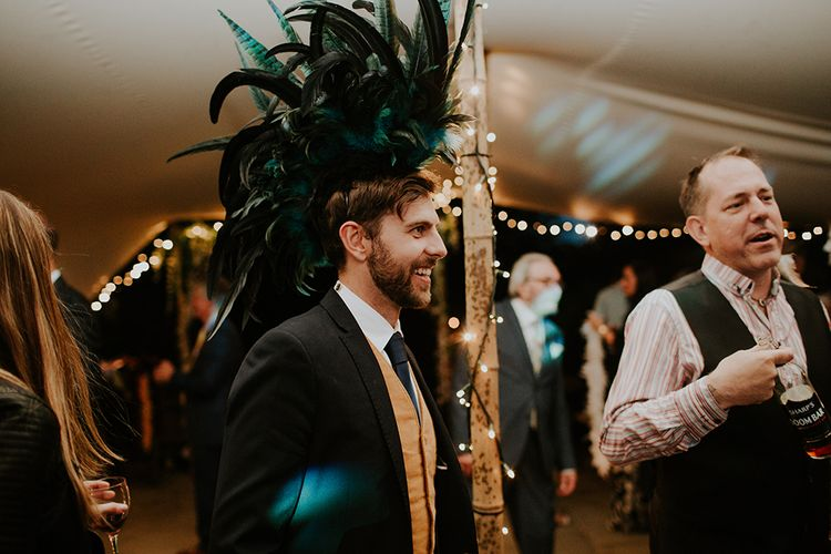Feather Hat | Dressing Up Box | Feather & Foliage Festival Wedding Weekend at Copse House, Berkshire | Irene Yap Photography | Tanita Cox Films
