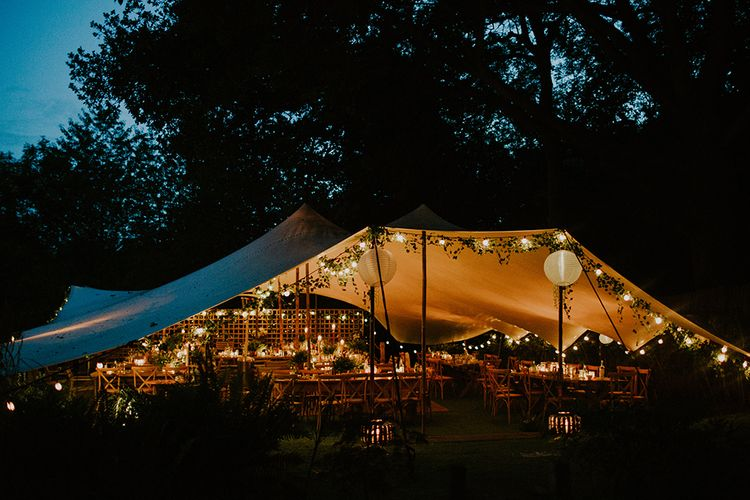 Stretch Tent Reception with Festoon Light Decor | Feather & Foliage Festival Wedding Weekend at Copse House, Berkshire | Irene Yap Photography | Tanita Cox Films