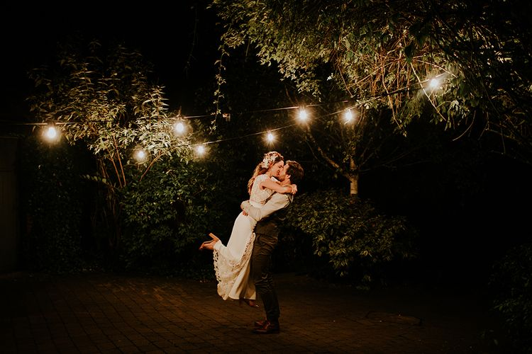 Festoon Lights | Bride in Amanda Thompson Couture Gown | Groom in Reiss Suit | Feather & Foliage Festival Wedding Weekend at Copse House, Berkshire | Irene Yap Photography | Tanita Cox Films