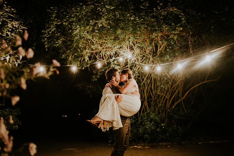Festoon Lights Wedding Decor | Bride in Amanda Thompson Couture Gown | Groom in Reiss Suit | Feather & Foliage Festival Wedding Weekend at Copse House, Berkshire | Irene Yap Photography | Tanita Cox Films