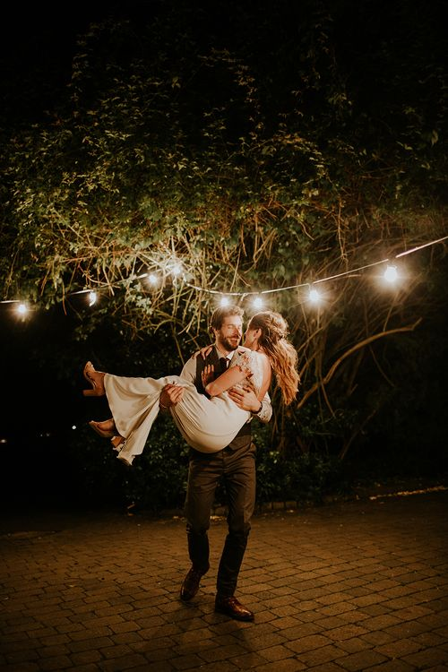 Strung Up Lights Wedding Decor | Bride in Amanda Thompson Couture Gown | Groom in Reiss Suit | Feather & Foliage Festival Wedding Weekend at Copse House, Berkshire | Irene Yap Photography | Tanita Cox Films