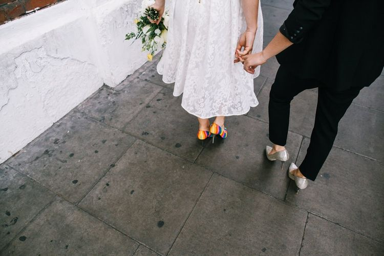 Ted Baker mid length laced wedding dress and rainbow shoes
