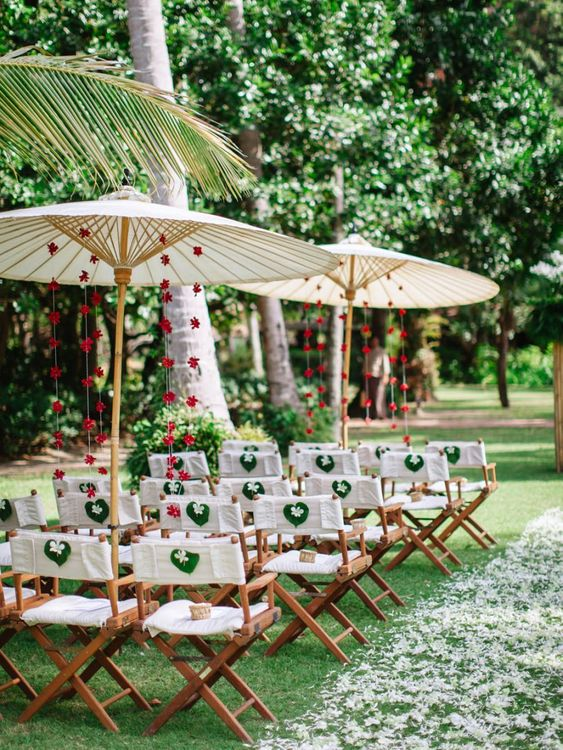 Outdoor ceremony seating at tropical wedding with parasols