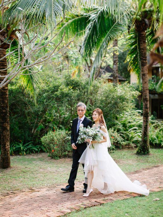 Wedding ceremony bridal entrance in organza wedding dress